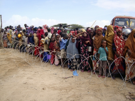 Families in Somalia waiting in line for UN resources during the recent famine and drought