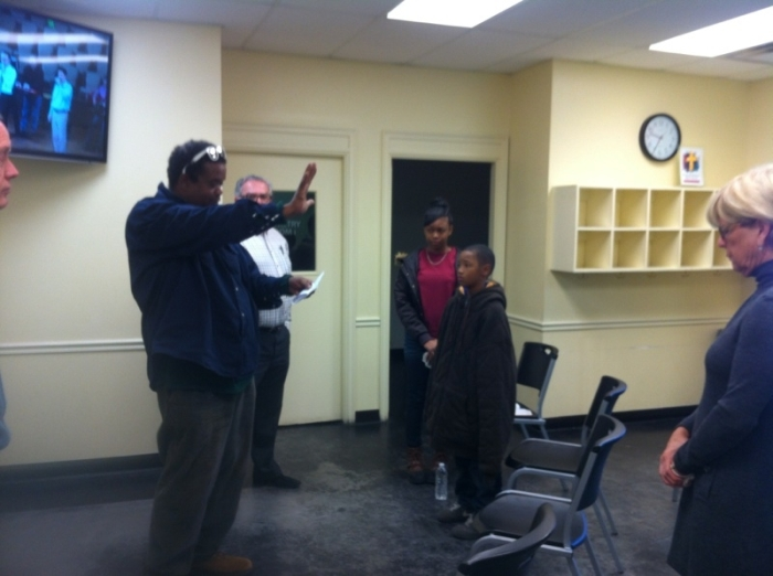 We have also started a small worship venue at the Caring Center downtown. Here, Joe leads our closing blessing.